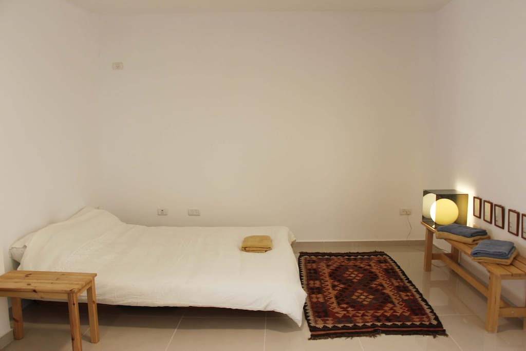Queen Size Bed with white linen