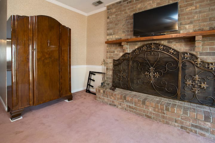 King bed room  1 down stairs fireplace