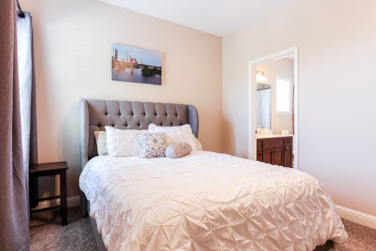 Comfortable queen size bed in enclosed bedroom with door for privacy from the rest of the bunkhouse.