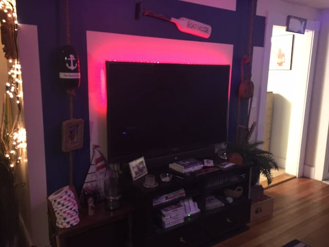 """Nautical theme throughout the apartment.  Living room equipped with A/C in the warmer months and a 60"""" TV"""