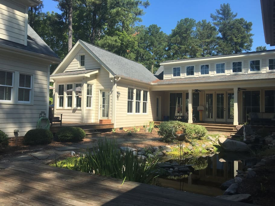 Awesome back yard with covered porch and pond