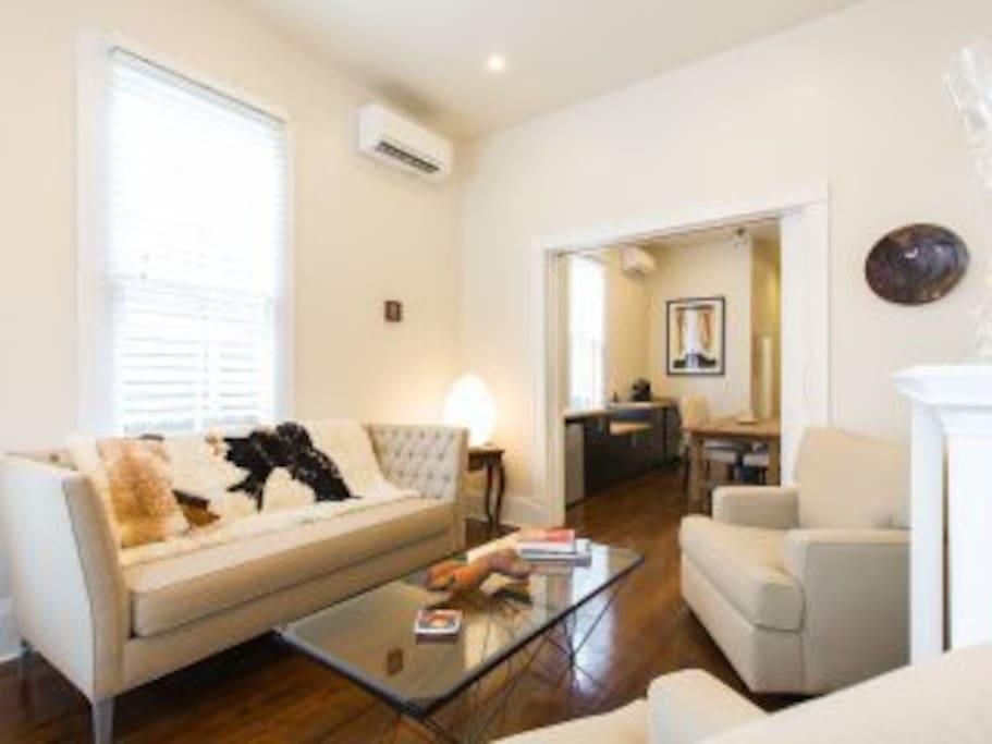 High ceilings, original hardwood floors, mantels, pocket doors and lots of natural light