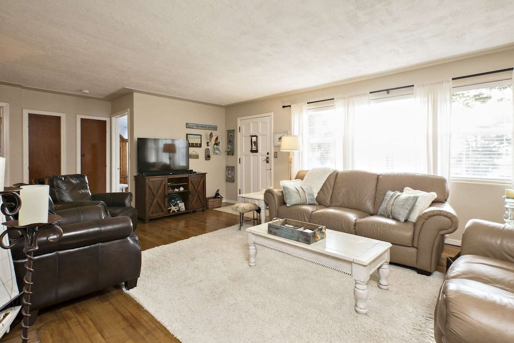 Living room features a large flat screen television, sound bar, Apple TV Box and WiFi.