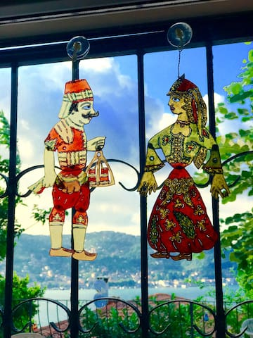 Traditional shadow theater characters on the window.