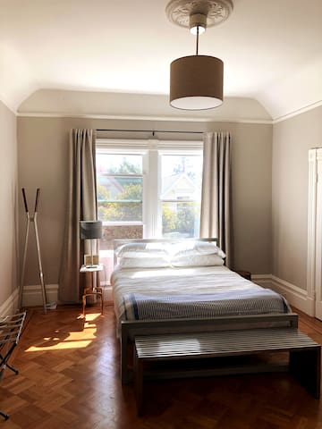 Spacious second bedroom with Tempur-Pedic queen size bed and views of Dolores Heights.