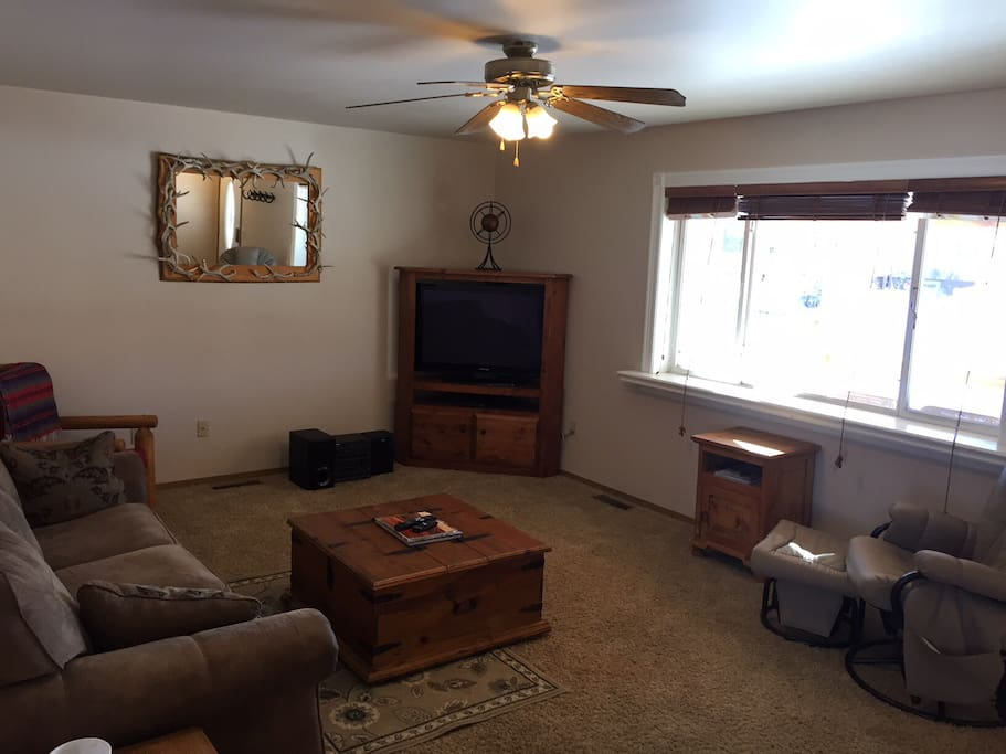 "Spacious living room, 43"" TV/DVD player, great picture window for watching the deer and letting the sunlight in!"