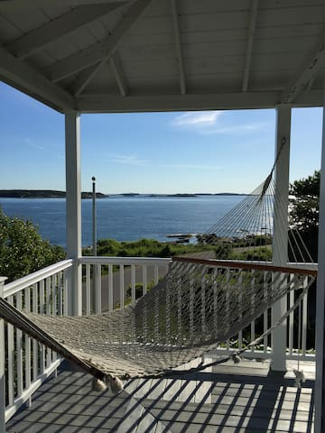 Wrap around porch with sweeping water views and ocean waves