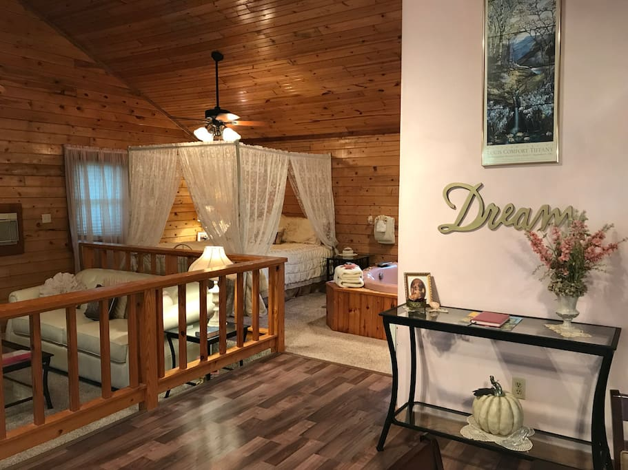 King sized bed, Jacuzzi for two and Step down living room under gorgeous vaulted ceilings
