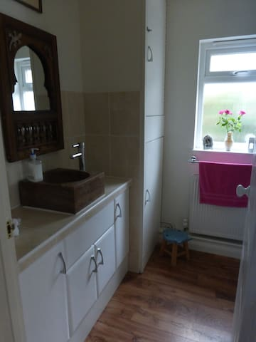 Separate en-suite room. Electric shower and WC.