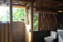 The bathroom with a shower and a view!