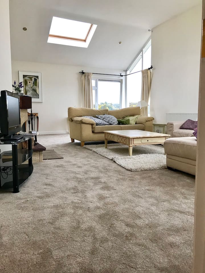 Large vaulted ceiling sitting room with open fire for extra comfort. Plenty of seating area for relaxing
