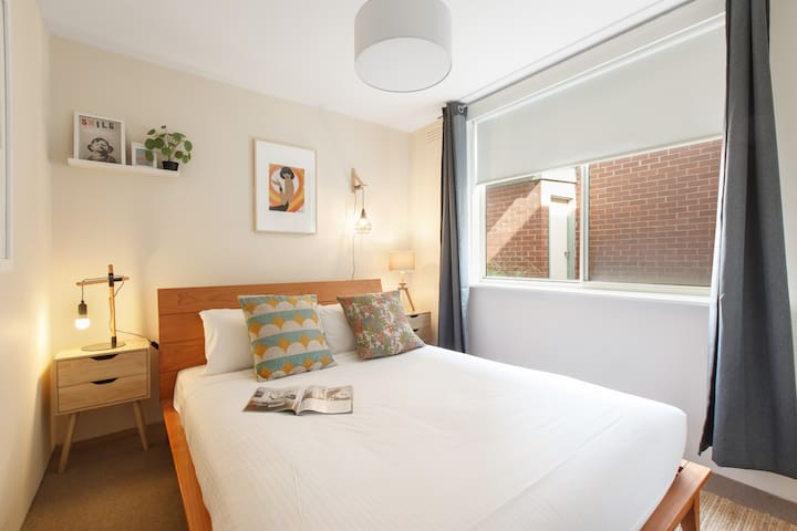 The main bedroom is complete with a plush queen bed, hotel quality linens and nice, new furnishings keeping the room fresh and cosy