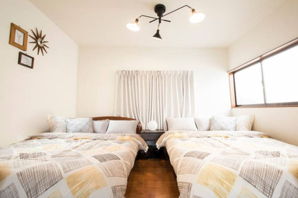 Bedroom with 2 double beds on 2F.