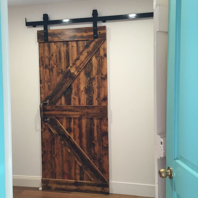 The bathroom 'barn door 'was made out of the floor boards of the original building.