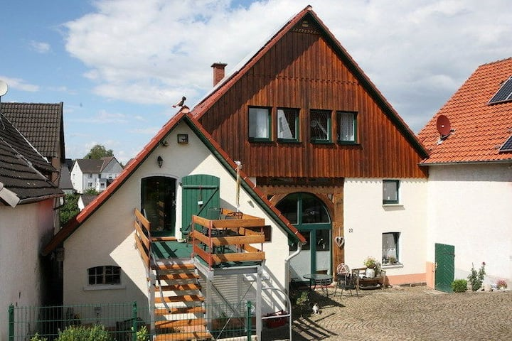 Beautiful holiday home in the Weser Uplands with sauna and fireplace