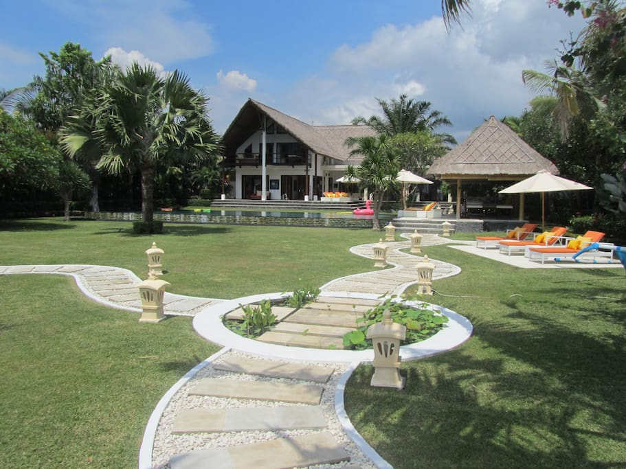 Villa frontage from the beach side. 600 square meters of covered living space in classic Balinese style