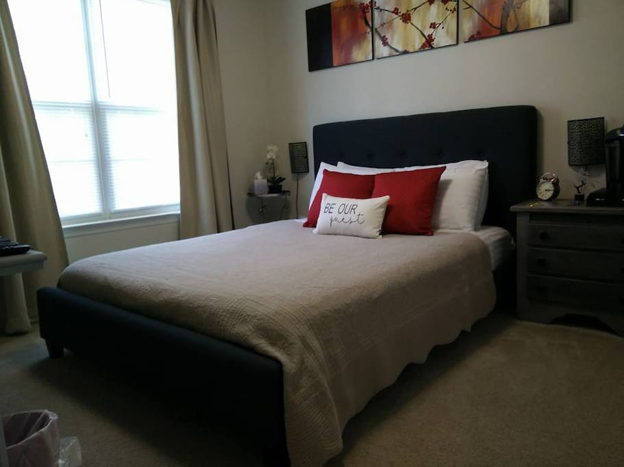 The guest room has a queen size low profile bed with newer medium-firm mattress.