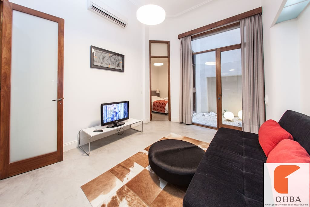 Minil living with acces to groundfloor suite, patio and and small living all at the backside