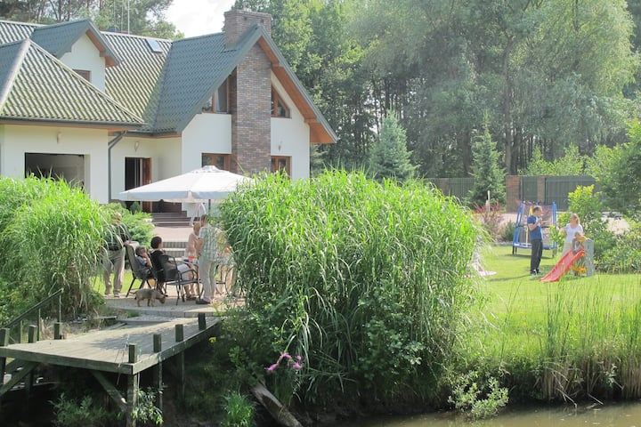 Beautiful house by the pond and forest near Warsaw