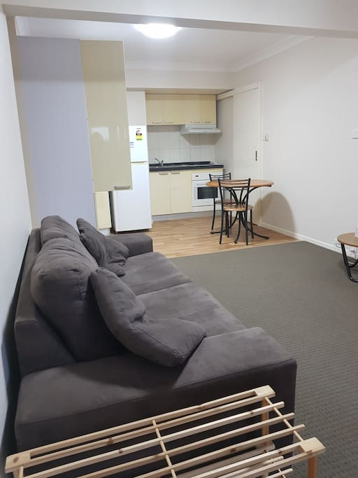 Robertson Airbnb Fully furnished unit open lounge room and Kitchen area.