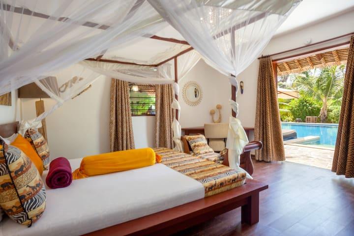 Luxury deluxe bedroom with pool view