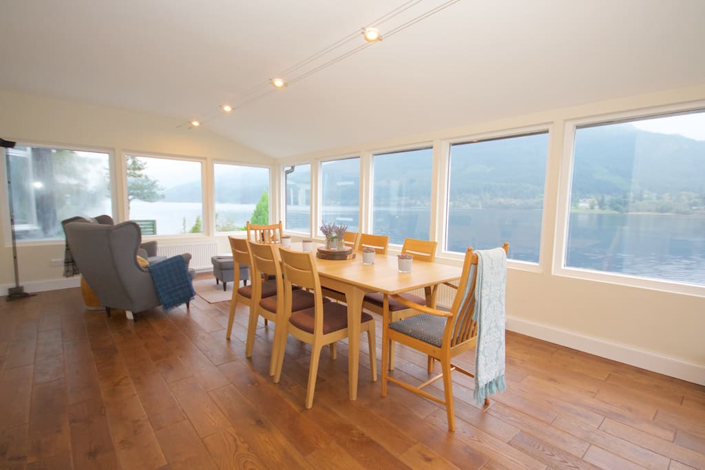 Front Room - With idyllic panoramic views of the surrounding loch and mountains. Enjoy a home cooked dinner in this shared space