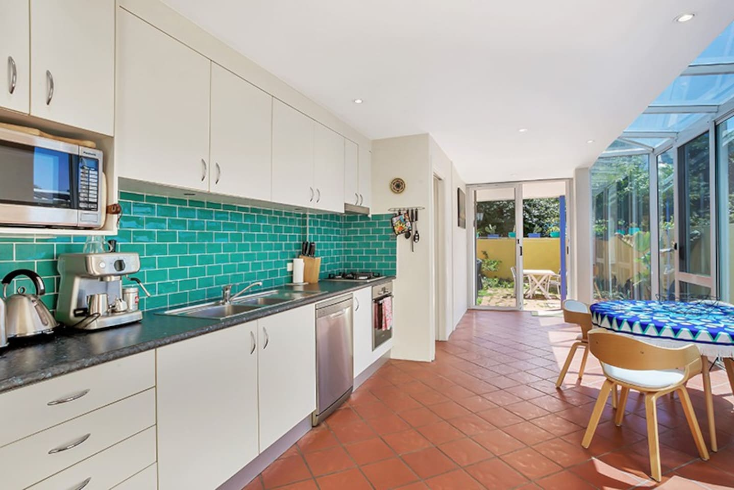 Bright kitchen opening to sunny courtyard