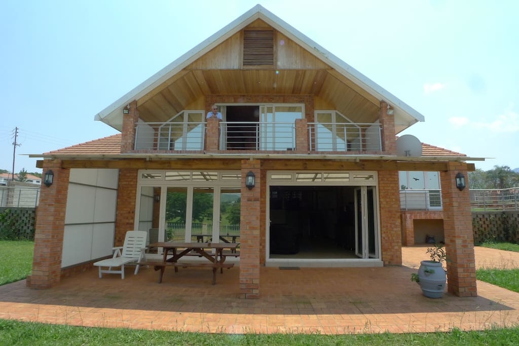Rear view of House with veranda and balcony/loggia
