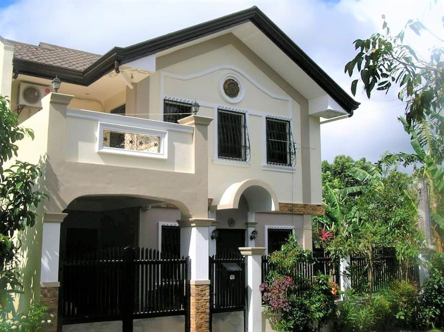 Front facade of the property, bedrooms are upstairs