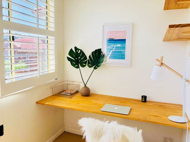 This sunroom/office (advertised as 3d bedroom) is north facing  with district views.  It has a desk, built in wardrobe. Can accomodate a portable cot or a single foldable mattress (on request). It has a door for privacy that opens to master bedroom.