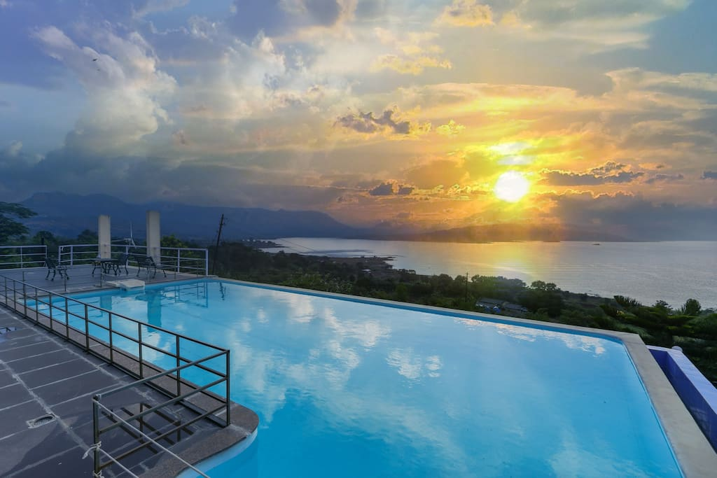 Enjoy the sun go down in the pool