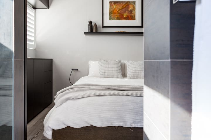 Bedroom with high-quality mattress topped with luxurious quality linen