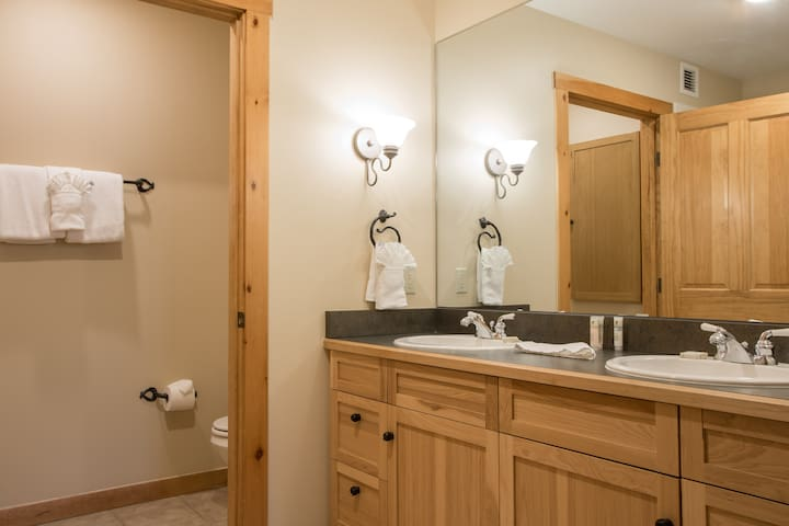 Private master bathroom with two sinks, hairdryer and lots of cabinet space. Soap and shampoo are included.