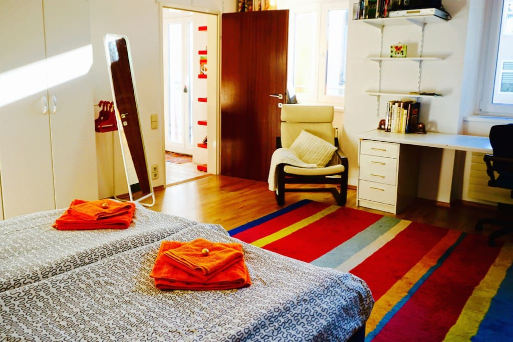 your bedroom: bed, mirror, hangers, desk, chair, shelves
