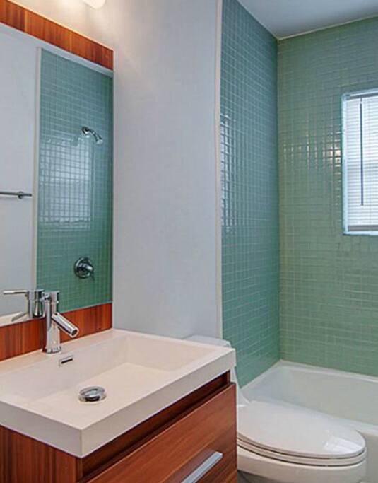 Modern bathroom with sliding door to the tub & shower