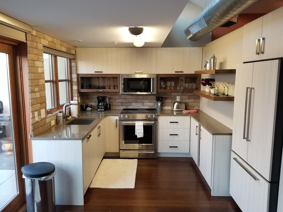 Brand New updated Kitchen w/ all the Glass and Dishware needed.