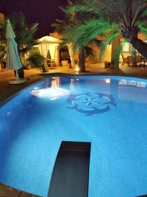 Swimming pool area at night time