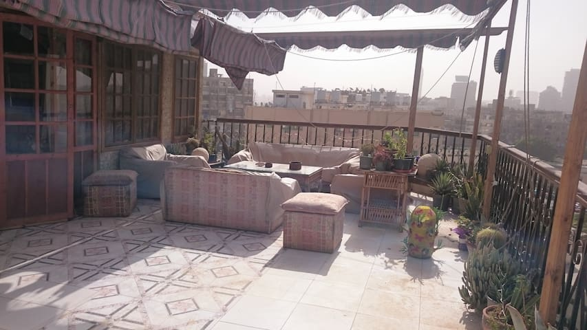Cozy room with private bathroom in Agouza rooftop
