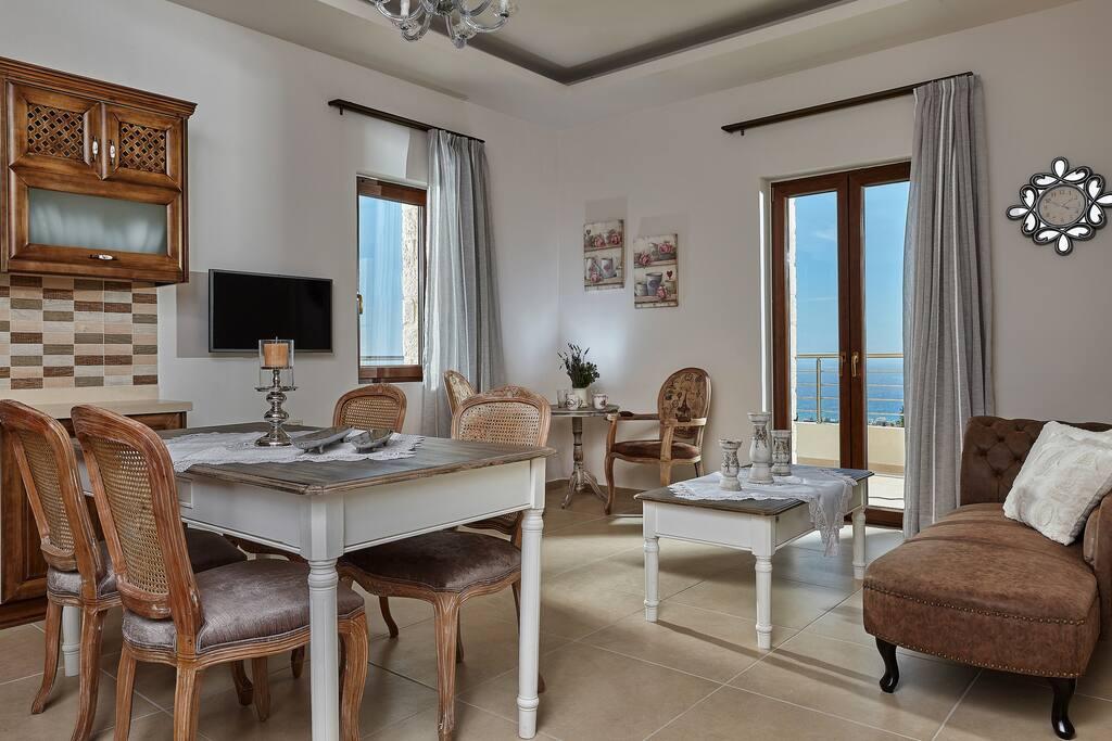 Orelia Cretan Deluxe Apartments - The Living Room 2