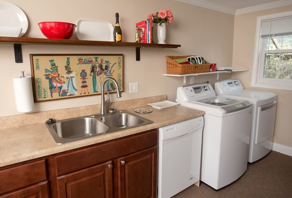 Full kitchen with washer and dryer and there is a clothes line on the patio.