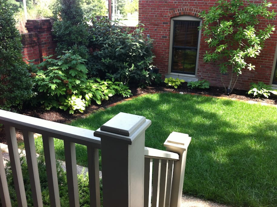 Courtyard and large side yard are off the porch. Great spot for morning coffee.