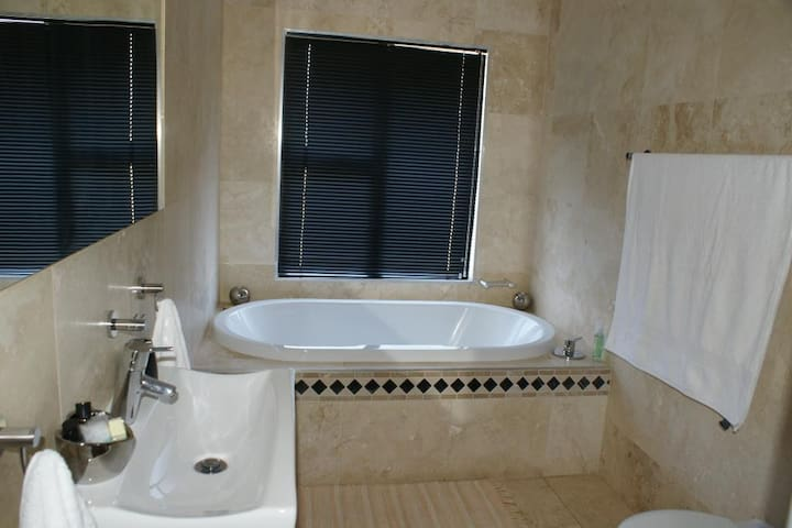 En-suite soaker tub. Both rooms have ensuite showers and tubs.