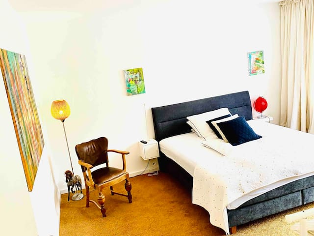 Master Bedroom - Extra large exclusive bedroom with brand New Boxspring Bed, remote controlled dimmable lights and private access to balcony. 55 inch 5k Smart flatscreen TV with super fat internet. Feel free to anchor.