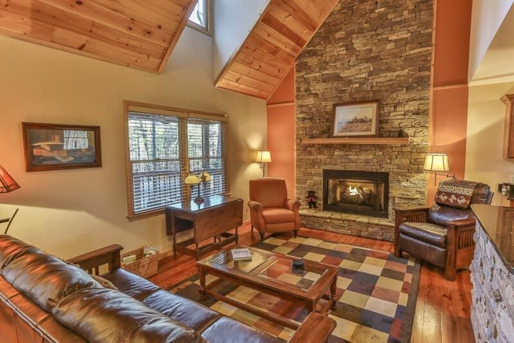 Living room with rocked gas log fireplace