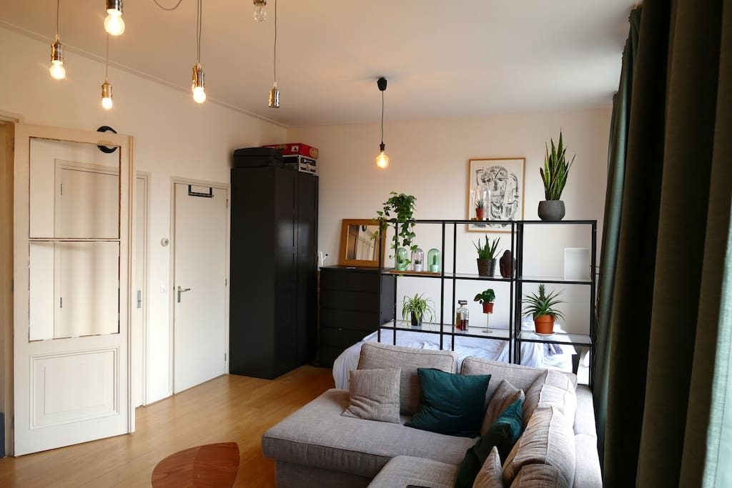 Bright urban living room with double bed