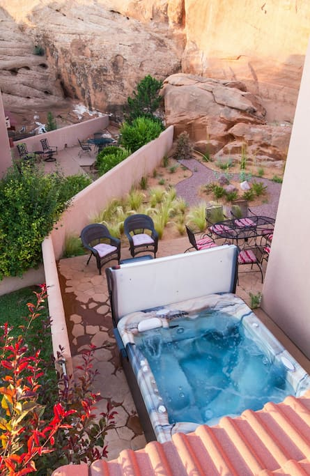 View of our large private hot tub and patio from the upper deck.