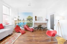 Loft C living space with two twin beds that act as sofas. Floor is perfect for yoga or dancing!