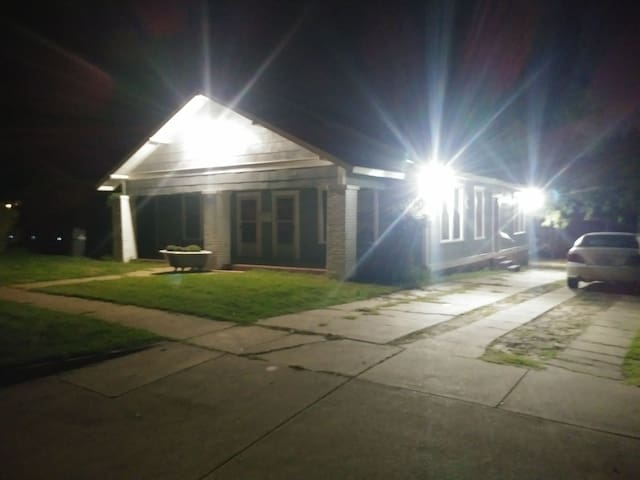 Night time view.  Well light with front flood light and side motion detection lights.