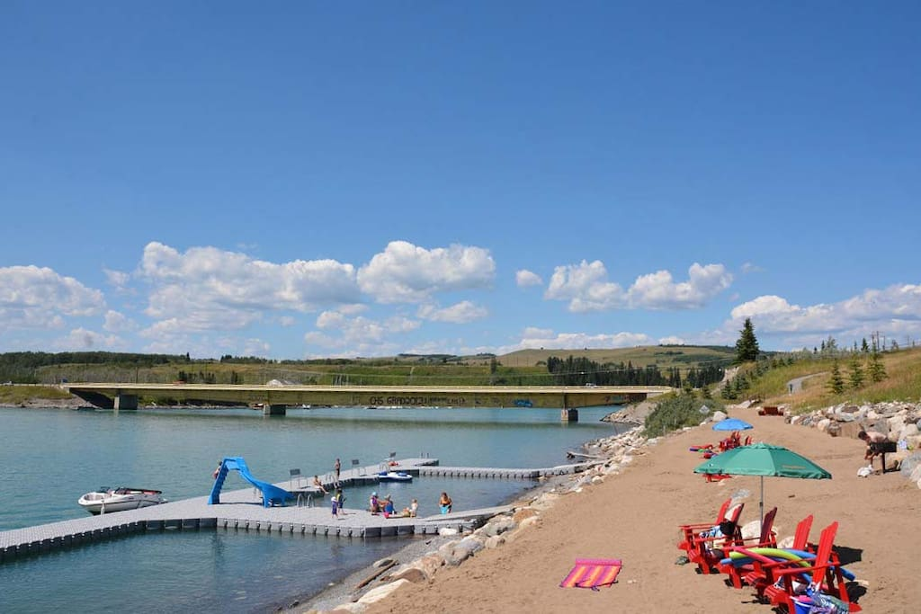 Private beach with boat launch floating docks and slide