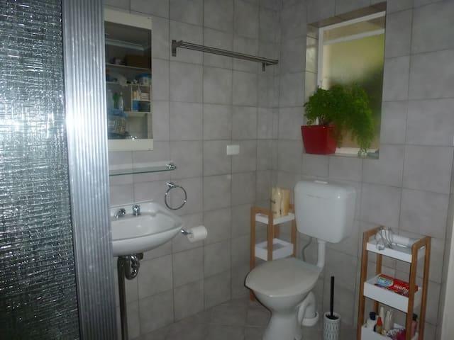 Spacious bathroom/laundry.